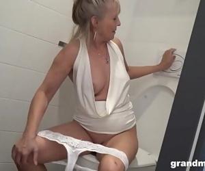 Blonde granny puts toilet..