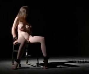Restrained to metal chair..
